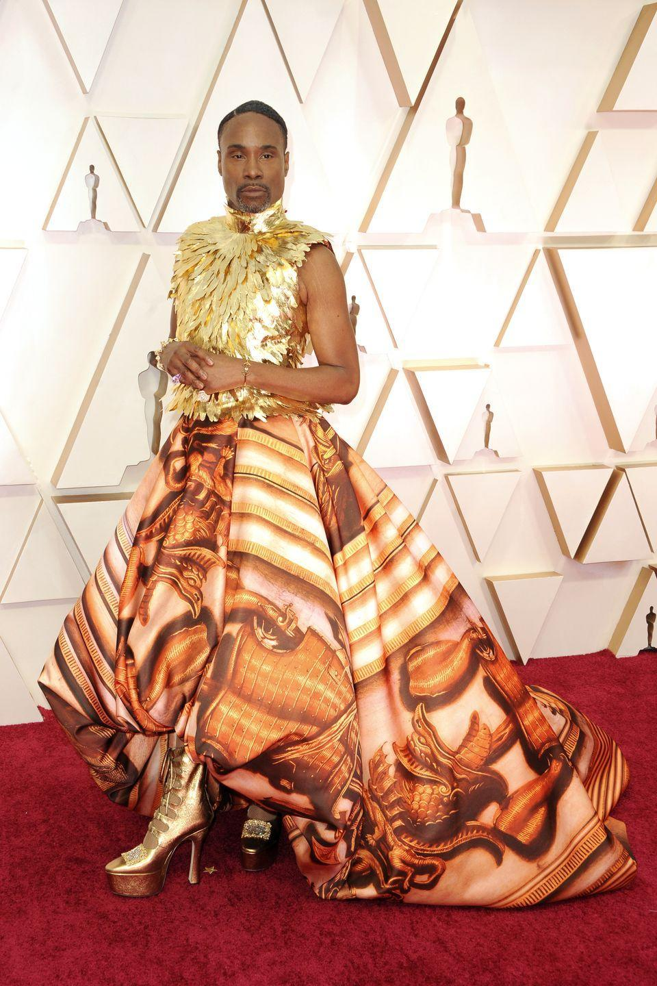 <p>Porter at the 92nd annual Academy Awards in a gold feathered bodice and printed skirt with gold platform boots. </p>