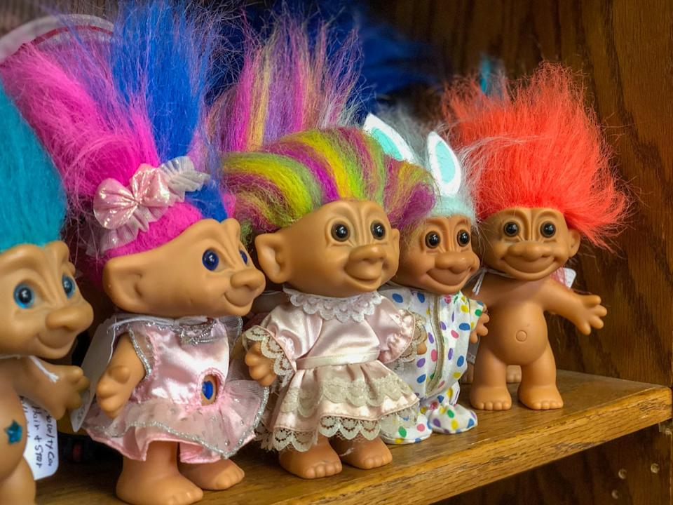 troll dolls on a shelf