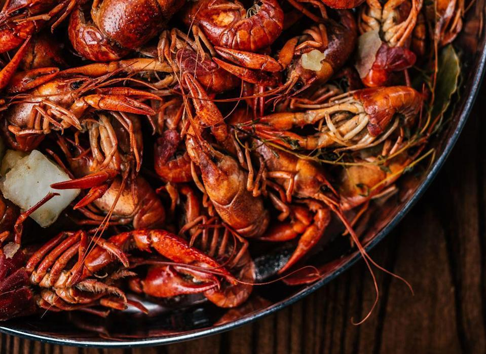 """<p>You can likely find a crawfish boil happening at many of <a href=""""https://www.thedailymeal.com/eat/americas-best-seafood-shacks-gallery?referrer=yahoo&category=beauty_food&include_utm=1&utm_medium=referral&utm_source=yahoo&utm_campaign=feed"""" rel=""""nofollow noopener"""" target=""""_blank"""" data-ylk=""""slk:America's best seafood shacks"""" class=""""link rapid-noclick-resp"""">America's best seafood shacks</a>. But now you can get the same enjoyment right at home. Though it is a long process and may get messy, it's worth it for the joy of chowing down on crawfish with family and friends.</p> <p><a href=""""https://www.thedailymeal.com/recipes/crawfish-boil-david-kinch-recipe?referrer=yahoo&category=beauty_food&include_utm=1&utm_medium=referral&utm_source=yahoo&utm_campaign=feed"""" rel=""""nofollow noopener"""" target=""""_blank"""" data-ylk=""""slk:For the Crawfish Boil recipe, click here."""" class=""""link rapid-noclick-resp"""">For the Crawfish Boil recipe, click here.</a></p>"""