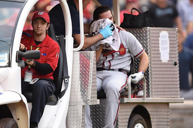 Charlie Culberson of the Atlanta Braves is taken off the field after getting hit by a pitch in the seventh inning. (Photo by Mitchell Layton/Getty Images)