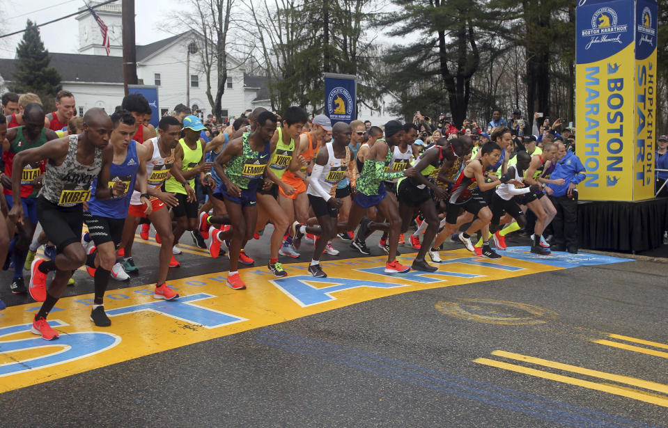 "FILE - In this April 15, 2019, file photo, the elite men break from the start of the 123rd Boston Marathon in Hopkinton, Mass. Next year's Boston Marathon has been postponed. The Boston Athletic Association says that it won't hold the race as scheduled in April because of the COVID-19 pandemic. Organizers say it will be put off ""at least until the fall of 2021."" This year's marathon was initially postponed until the fall and later canceled outright. (AP Photo/Stew Milne, File)"