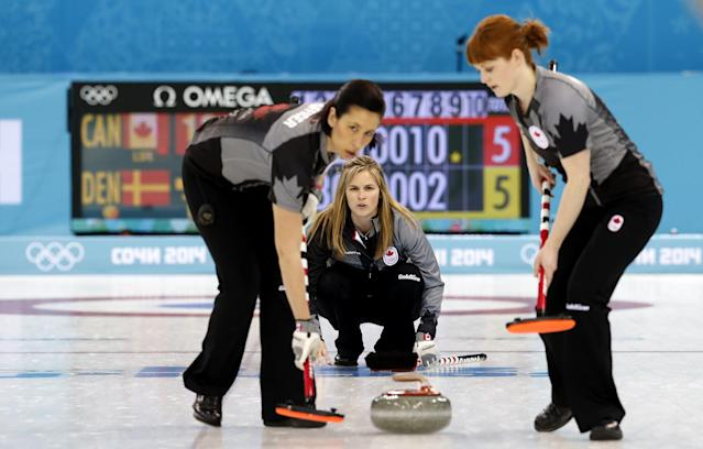 Canada's skip Jennifer Jones, center, watches her teammates Jill Officer, left, and Dawn McEwen, right, during the women's curling competition against Denmark at the 2014 Winter Olympics, Thursday, Feb. 13, 2014, in Sochi, Russia. (AP Photo/Wong Maye-E)