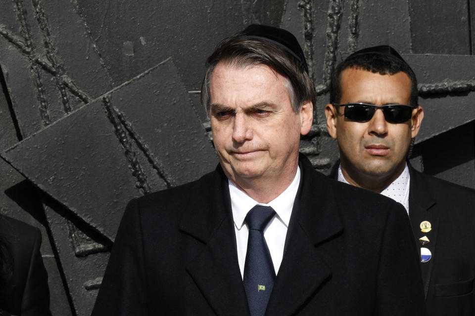TOPSHOT - President of the Federative Republic of Brazil Jair Bolsonaro reacts during his visit to the Yad Vashem Holocaust Memorial museum in Jerusalem commemorating the six million Jews killed by the Nazis during World War II. - Bolsonaro has expressed his strong support for Israel and spoken of being moved by a Christian pilgrimage to the Jordan River he undertook a couple of years ago. (Photo by GALI TIBBON / AFP)        (Photo credit should read GALI TIBBON/AFP via Getty Images)
