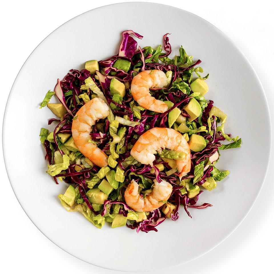 <p>In this healthy Asian-inspired shrimp salad recipe, two types of greens--romaine lettuce and red cabbage--pair beautifully with the avocado and shrimp. Use extra dressing for another salad or as a sauce for baked fish.</p>