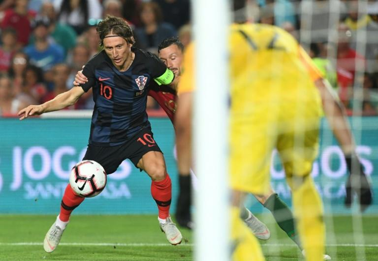Modric regularly escapes the attentions of physically bigger players