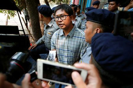 Detained Reuters journalist Wa Lone talks to reporters after a court hearing in Yangon, Myanmar March 14, 2018. REUTERS/Stringer