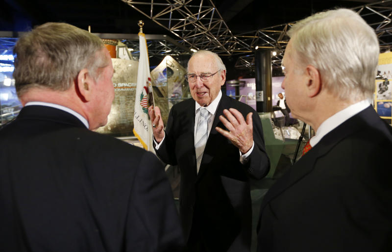 "Captain James A. Lovell, Jr, center, speaks with President and CEO of Chicago's Museum of Science and Industry, David R. Mosena, right, and journalist Frank Mathie, left, during 45th Anniversary of Apollo 8 ""Christmas Eve Broadcast to Earth"" event at the Museum of Science and Industry in Chicago, Monday, Dec. 23, 2013. (AP Photo/Kamil Krzaczynski)"