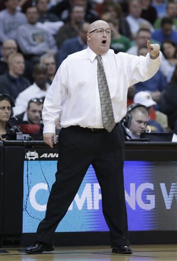 Western Michigan coach Steve Hawkins reacts makes a point during the first half of an NCAA college basketball game against Ohio in the semifinals of the Mid-American Conference tournament Friday, March 15, 2013, in Cleveland. Ohio won 74-63. (AP Photo/Tony Dejak)
