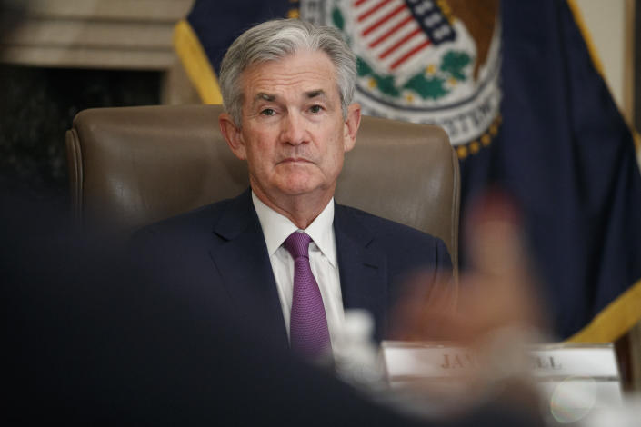 FILE - In this Oct. 4, 2019, file photo Federal Reserve Chairman Jerome Powell listens to feedback during a panel at the Federal Reserve Board Building in Washington. On Tuesday, Oct. 8, Powell is scheduled to speak about the Fed's interest rate policy in Denver at the annual meeting of the National Association for Business Economics. (AP Photo/Jacquelyn Martin, File)