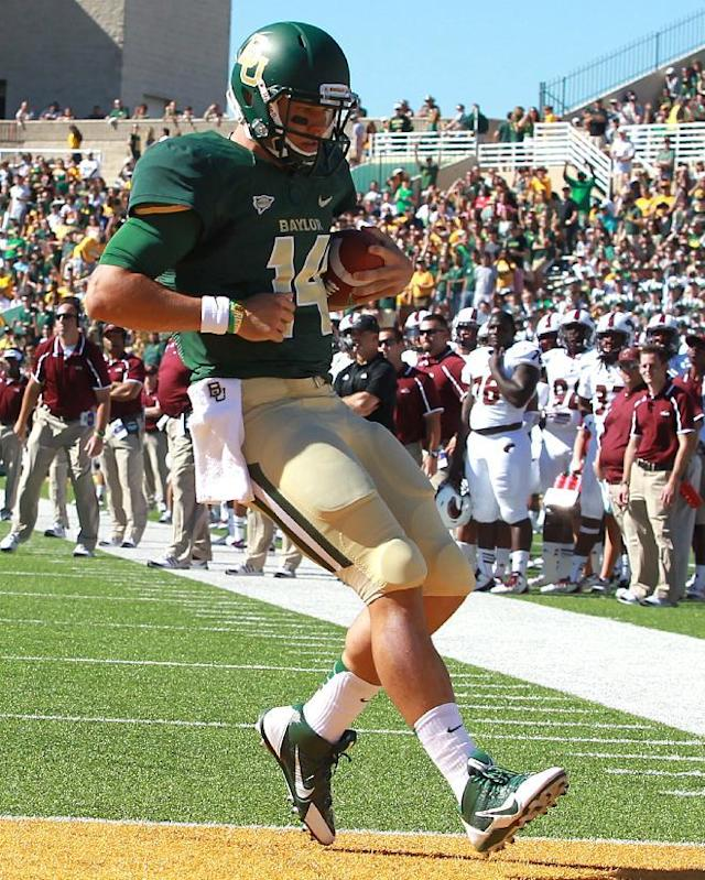 Baylor quarterback Bryce Petty (14) scores a touchdown in the first half of an NCAA college football game against Louisiana-Monroe, Saturday, Sept. 21, 2013, in Waco, Texas. (AP Photo/Waco Tribune Herald, Jerry Larson)