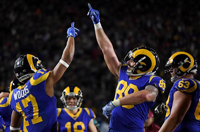 Wide receiver Robert Woods (17) and tight end Tyler Higbee (89) of the Los Angeles Rams celebrate Woods' touchdown. (Photo by Harry How/Getty Images)