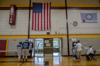 Voters casted their votes at the Roosevelt High School polling location, Tuesday, August 11, 2020 in Minneapolis. (Elizabeth Flores/Star Tribune via AP)