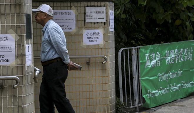 Polling station preparations at Sai Ying Pun Community Complex Community Hall. Photo: Jonathan Wong.