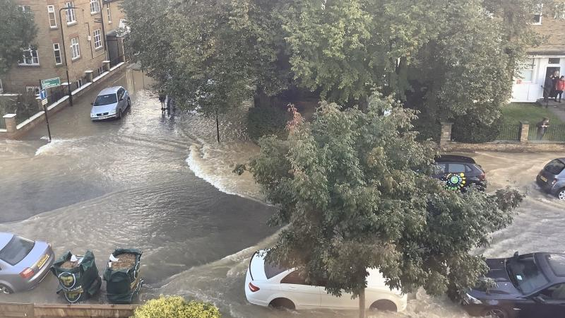 Firefighters evacuated residents as burst water main floods London street