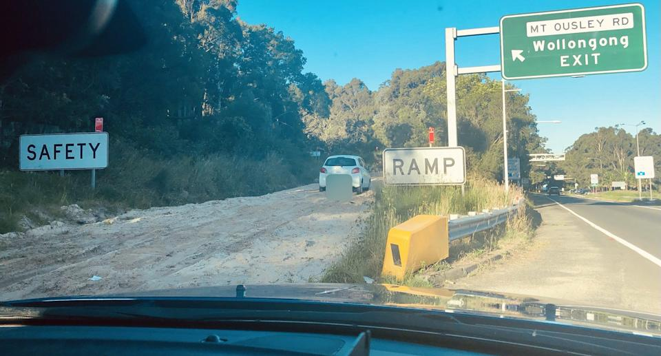 A white Mitsubishi Mirage pictured parked on a safety ramp at the bottom of Mount Ousley Road, Wollongong.
