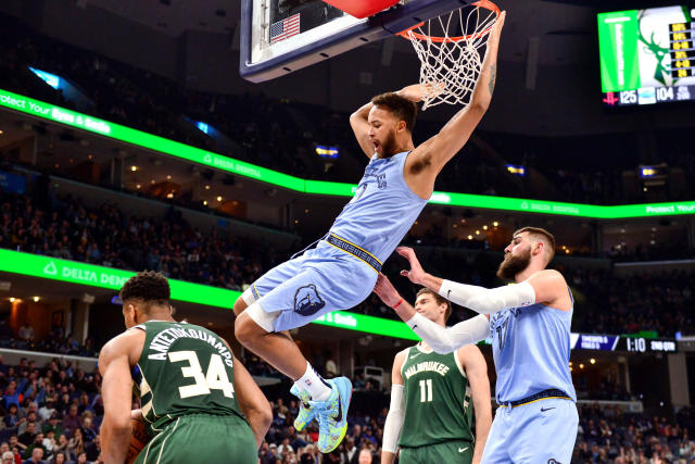 Memphis Grizzlies forward Kyle Anderson (1) dunks against Milwaukee Bucks forward Giannis Antetokounmpo (34) in the first half of an NBA basketball game Friday, Dec. 13, 2019, in Memphis, Tenn. (AP Photo/Brandon Dill)