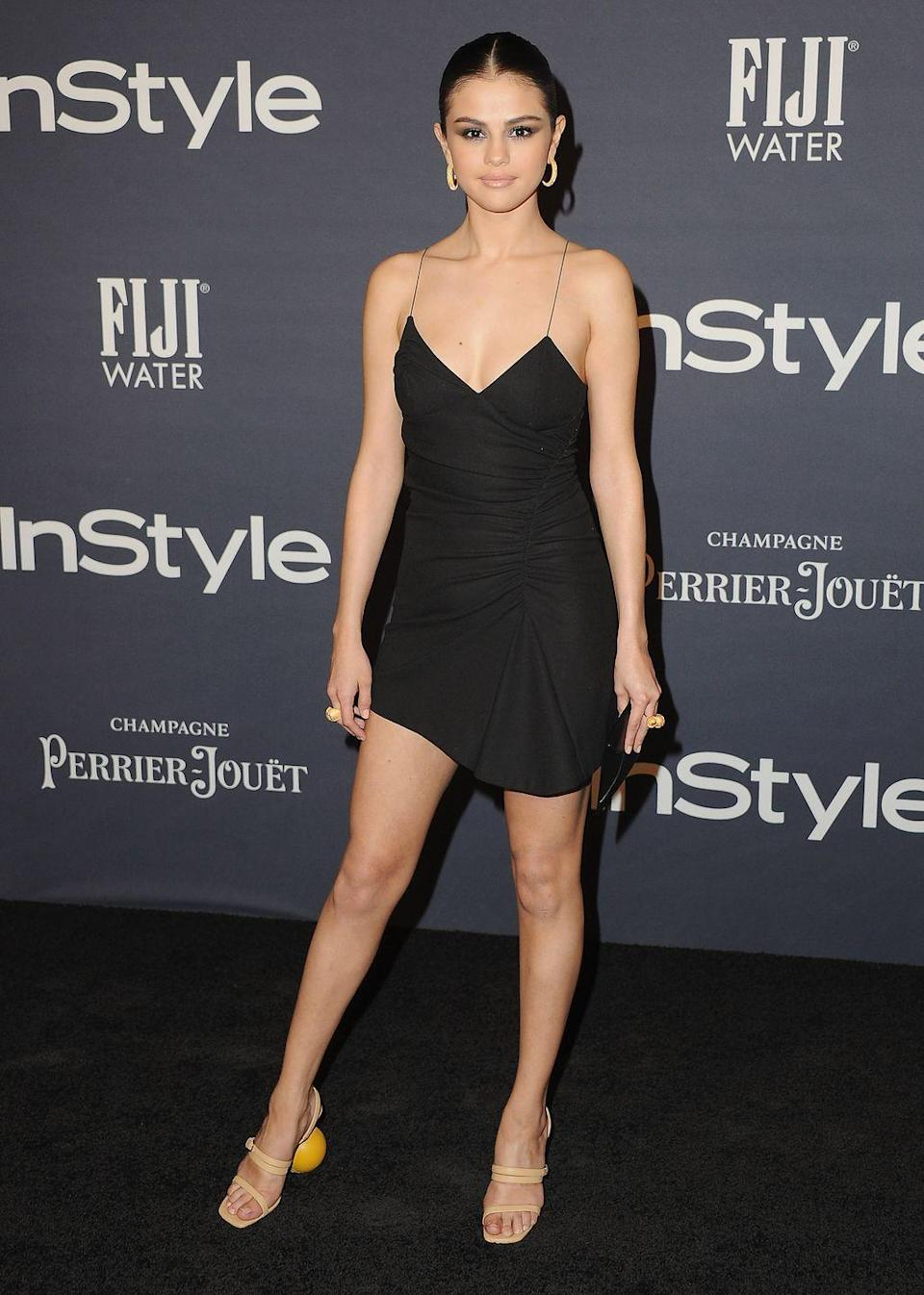 """<p>Selena Gomez dominated the red carpet at the InStyle Awards in a black 90s-inspired strappy dress and Simon <a href=""""http://www.elleuk.com/fashion/celebrity-style/news/a39502/selena-gomez-just-wore-the-ultimate-pair-of-geometric-heels-for-night-out-with-elle-fanning/"""" rel=""""nofollow noopener"""" target=""""_blank"""" data-ylk=""""slk:Jacquemus-designed block heels"""" class=""""link rapid-noclick-resp"""">Jacquemus-designed block heels</a>, October 2017</p>"""