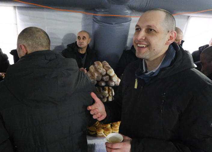 A pro-Ukrainian prisoner reacts after a prisoner exchange between Ukrainian and pro-Russian rebels sides, not far from the Maiorske checkpoint, Donetsk area, Ukraine, Sunday, Dec. 29, 2019. Ukrainian forces and Russia-backed rebels in eastern Ukraine began exchanging prisoners Sunday in a move aimed at ending their 5-year-long war. (Yevgen Honcharenko/Pool Photo via AP)