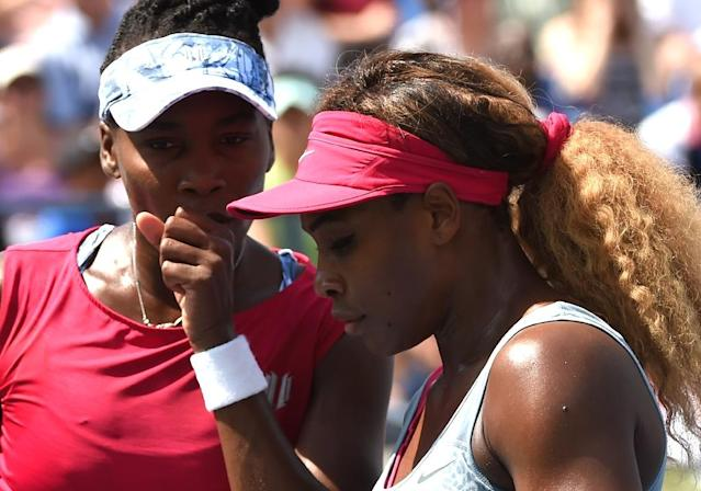 Serena Williams (R), coached by her father Richard, was toughened on the streets of Los Angeles and by practices with older sister Venus (L), a seven-time major champion (AFP Photo/Timothy A. Clary)