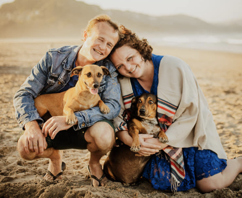 Robert Frauenstein, 38, pictured with fiancee Jana Hiles and two dogs.