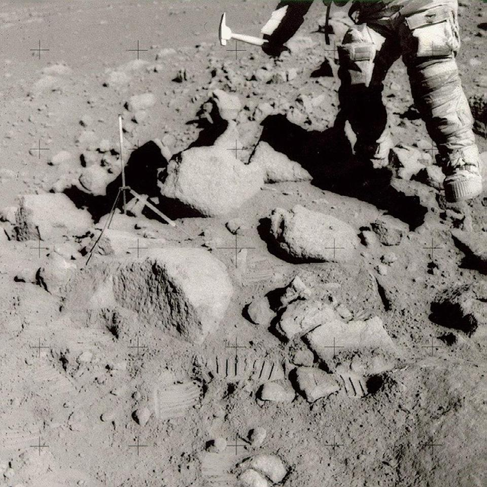 Apollo astronauts used hammers to break small chips off large moon rocks and to drive core tubes into the ground. <cite>NASA/Johnson Space Center</cite>