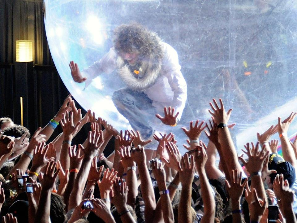 The Flaming Lips performing with a bubble in 2011. Unlike their recent concert, the audience were not given bubbles of their own (Getty)
