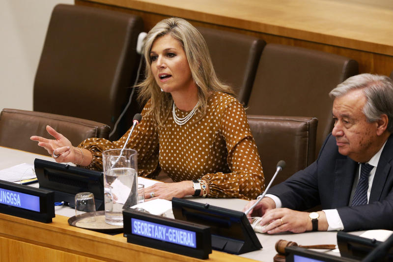 FILE - In this Wednesday, Sept. 25, 2019 file photo, Queen Maxima of the Netherlands is joined by United Nations Secretary-General Antonio Guterres as she delivers remarks at a side event regarding financial inclusion for development during the 74th session of the U.N. General Assembly, at U.N. headquarters. As the British royal family wrestles with the future roles of Prince Harry and his wife Meghan, it could look to Europe for examples of how princes and princesses have tried to carve out careers away from the pomp and ceremony of their families' traditional duties. Willem-Alexander's wife Maxima has plenty of royal duties but also acts as the United Nations Secretary-General's Special Advocate for Inclusive Finance for Development. (AP Photo/Jason DeCrow, File)
