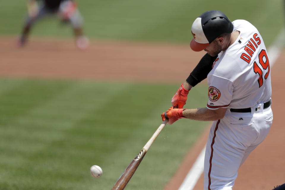 Baltimore Orioles' Chris Davis singles in a run off Boston Red Sox starting pitcher Andrew Cashner during the second inning of a baseball game, Sunday, July 21, 2019, in Baltimore. (AP Photo/Julio Cortez)