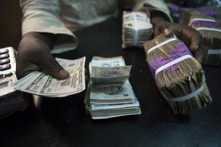 A Trader Changes Dollars With Naira At Currency Exchange In Lagos