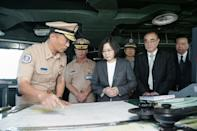 Taiwan's President Tsai Ing-wen (C) meets with officers on the deck of a warship before the vessel heads for Taipei-controlled Taiping island in the Spratly island chain of South China Sea, on July 13, 2016