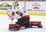 Ottawa Senators goalie Matt Murray makes a glove-save during the second period of an NHL hockey game in Vancouver, British Columbia, Thursday, April 22, 2021. (Darryl Dyck/The Canadian Press via AP)