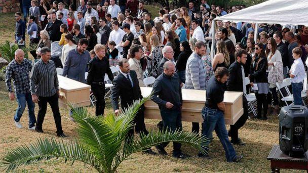 PHOTO: Men carry the caskets of Dawna Ray Langford, 43, and her sons Trevor, 11, and Rogan, 2, who were killed by drug cartel gunmen, during their funeral at the cemetery in La Mora, Sonora state, Mexico, Nov. 7, 2019. (Marco Ugarte/AP)