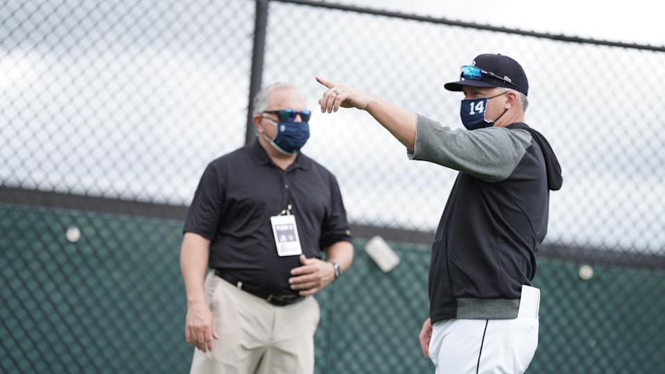 Detroit Tigers manager AJ Hinch (right) talks with general manager Al Avila during spring training Feb. 19, 2021, in Lakeland, Florida.
