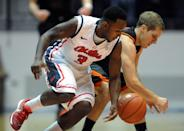 Mississippi's Derrick Millinghaus (3) goes for the ball against Mercer's Kevin Canevari (3) during an NCAA college basketball game in Oxford, Miss., on Sunday, Dec. 22, 2013. (AP Photo/Oxford Eagle, Bruce Newman)