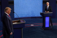President Donald Trump and Democratic presidential candidate former Vice President Joe Biden walk on stage during the second and final presidential debate Thursday, Oct. 22, 2020, at Belmont University in Nashville, Tenn. (AP Photo/Morry Gash, Pool)