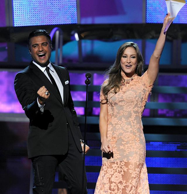 LAS VEGAS - NOVEMBER 11: Actor Jaime Camil (L) and singer Claudia Leitte present an award onstage during the 11th annual Latin GRAMMY Awards at the Mandalay Bay Events Center on November 11, 2010 in Las Vegas, Nevada. (Photo by Kevin Winter/Getty Images for LARAS)