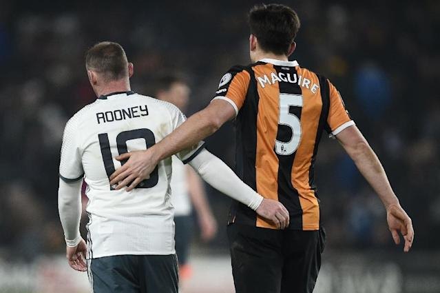 Manchester United's Wayne Rooney (L) greets Hull City's defender Harry Maguire after their EFL Cup semi-final match in Kingston upon Hull, north east England on January 26, 2017 (AFP Photo/Oli SCARFF )