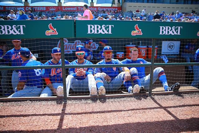 <p>New York Mets minor leaguers sits on the bench before the baseball game against the Miami Marlins at Roger Dean Chevrolet Stadium in Jupiter, Fla., March 3, 2018. (Photo: Gordon Donovan/Yahoo News) </p>