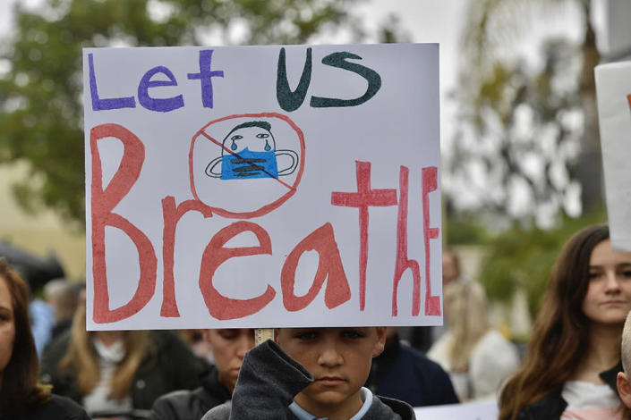 Chase Beamish, 12, listens to a speaker during an anti-mask rally outside the Orange County Department of Education in Costa Mesa, California, on Monday, May 17. More than 200 people came out to protest children in school being forced to wear masks. (Jeff Gritchen / Orange County Register via Getty Images)