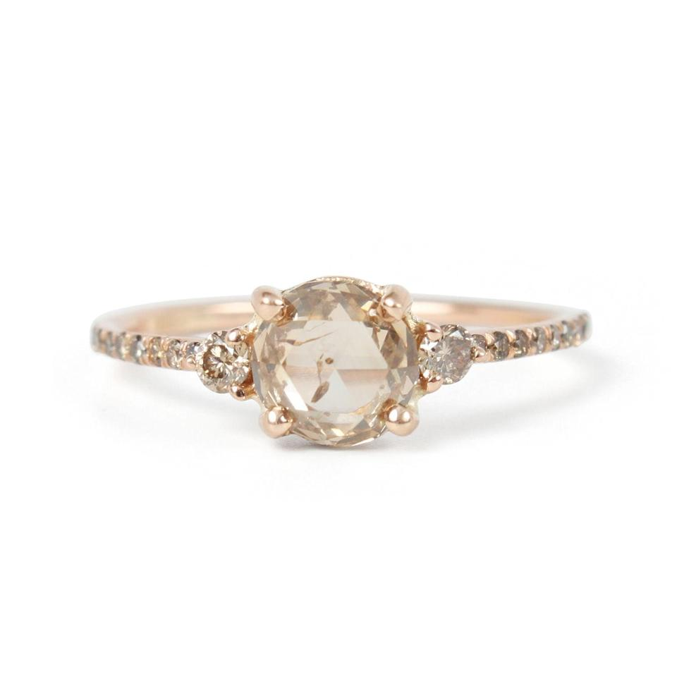 """<p>Cheers to the delicate beauty of the <a href=""""https://www.popsugar.com/buy/Champagne-Diamond-Solitaire-Ring-531016?p_name=Champagne%20Diamond%20Solitaire%20Ring&retailer=catbirdnyc.com&pid=531016&price=4%2C875&evar1=fab%3Aus&evar9=44555978&evar98=https%3A%2F%2Fwww.popsugar.com%2Fphoto-gallery%2F44555978%2Fimage%2F47001592%2FChampagne-Diamond-Solitaire-Ring&list1=wedding%2Cjewelry%2Crose%20gold%2Cengagement%20rings&prop13=api&pdata=1"""" rel=""""nofollow noopener"""" class=""""link rapid-noclick-resp"""" target=""""_blank"""" data-ylk=""""slk:Champagne Diamond Solitaire Ring"""">Champagne Diamond Solitaire Ring</a> ($4,875).</p>"""