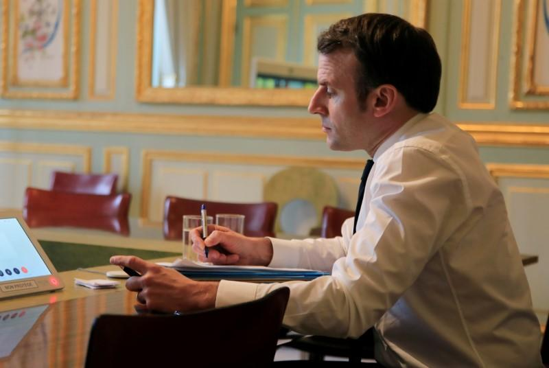 FILE PHOTO: French President Macron attends a videoconference with European leaders