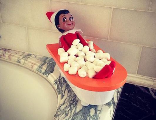 "Busy Philipps posted this photo to her Instagram account Dec. 22, 2013, with the caption ""While one elf was taking her long overdue marshmallow bath..."""