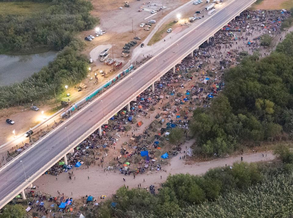 The Haitian migrants camp is seen from Mexican airspace on the Del Rio International Bridge in the border cities of Ciudad Acuna, Mexico and Del Rio, Texas.