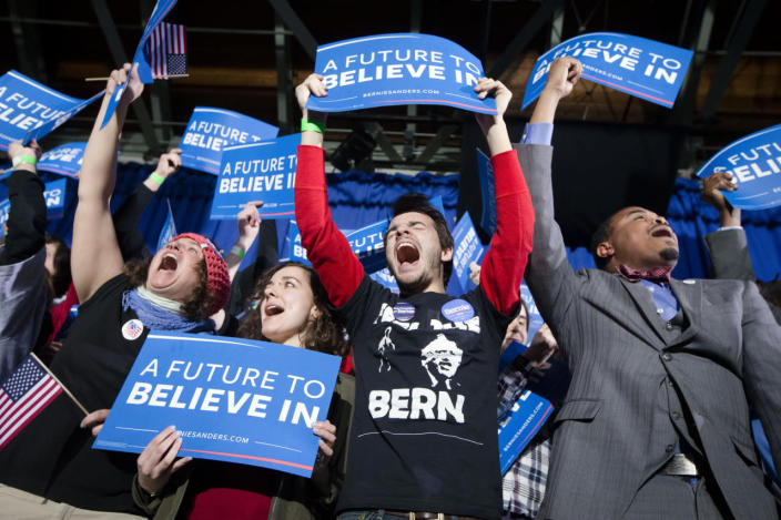 <p>Supporters of Democratic presidential candidate Sen. Bernie Sanders, I-Vt., cheer at a primary-night rally at Concord High School on Feb. 9, 2016, in Concord, N.H. (John Minchillo/AP)</p>