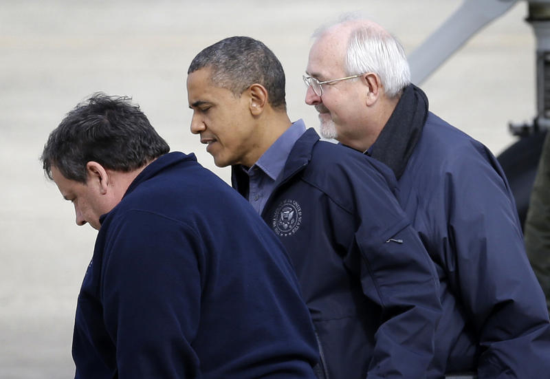 President Barack Obama, flanked by Federal Emergency Management Agency (FEMA) administrator Craig Fugate, right, and New Jersey Gov. Chris Christie, left, walks on the tarmac at Atlantic City International Airport, Wednesday, Oct. 31, 2012, in Atlantic City, NJ. Obama traveled to region to take an aerial tour of the Atlantic Coast in New Jersey in areas damaged by superstorm Sandy, (AP Photo/Patrick Semansky)