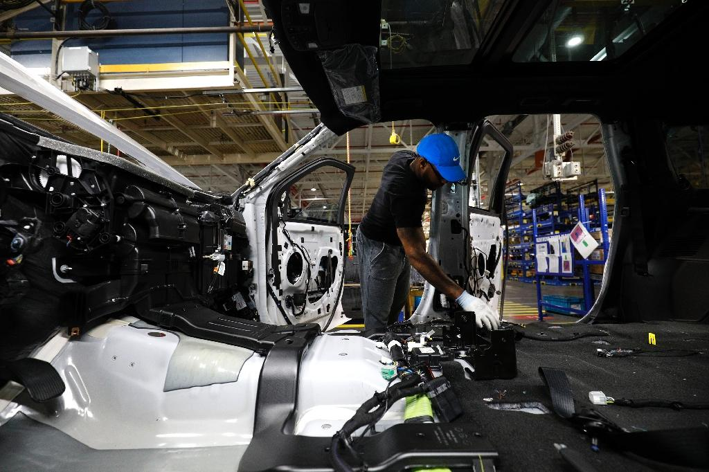 US manufacturing revenues are expected to rise 7.8 percent in 2018 (AFP Photo/BILL PUGLIANO)