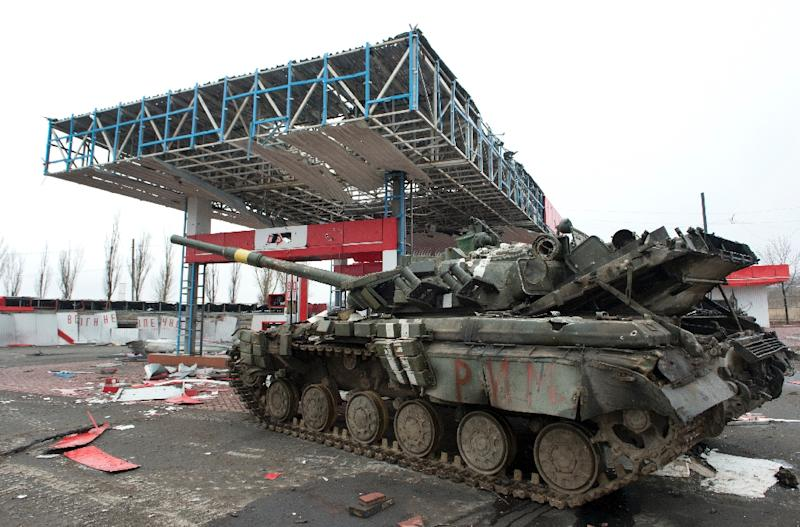A damaged Ukrainian army tank is immobilised in a wrecked petrol station outside the eastern city of Debaltseve, on February 28, 2015 (AFP Photo/John Macdougall)