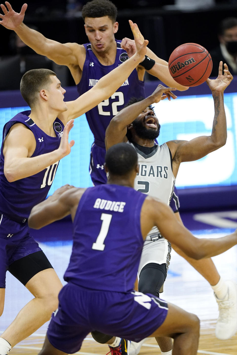 Chicago State guard Levelle Zeigler (2) can't control the ball as Northwestern forward Pete Nance (22), forward Miller Kopp, left, and guard Chase Audige guard during the first half of an NCAA college basketball game in Evanston, Ill., Saturday, Dec. 5, 2020. (AP Photo/Nam Y. Huh)