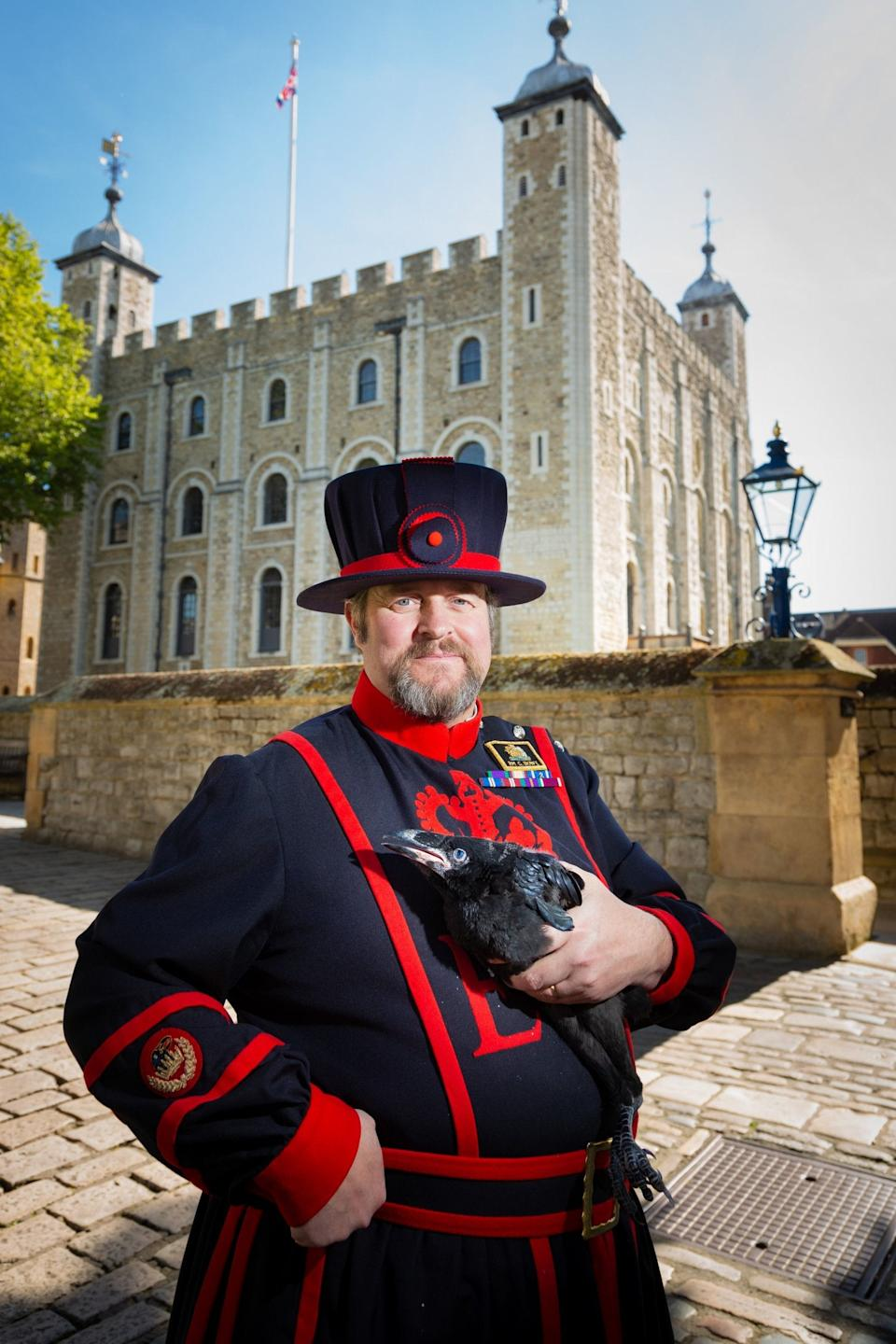 Ravenmaster Chris Skaife holding one of the first ravens to be born at the Tower in 30 years.PA