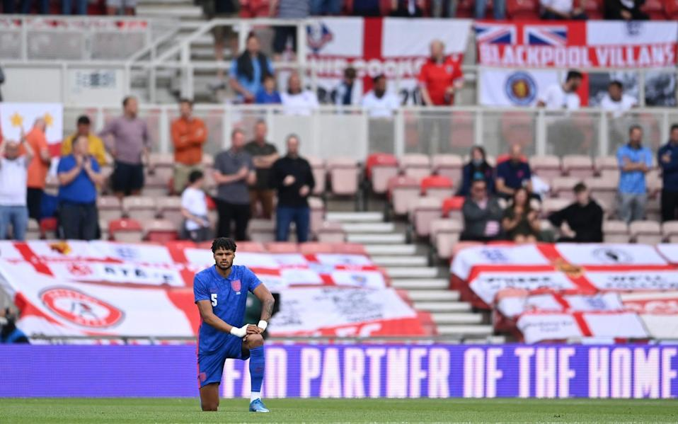 Tyrone Mings of England takes a knee in support of the Black Lives Matter movement prior to the international friendly match between England and Romania at Riverside Stadium on June 06 -Inside England's Supporters' Club: Even the most devoted fans are divided over taking the knee - FA COLLECTION